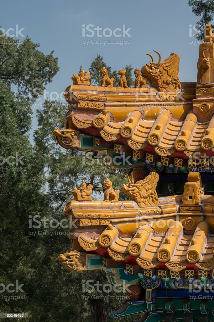 Chinese imperial temple roof decoration with mythical beast stock photo
