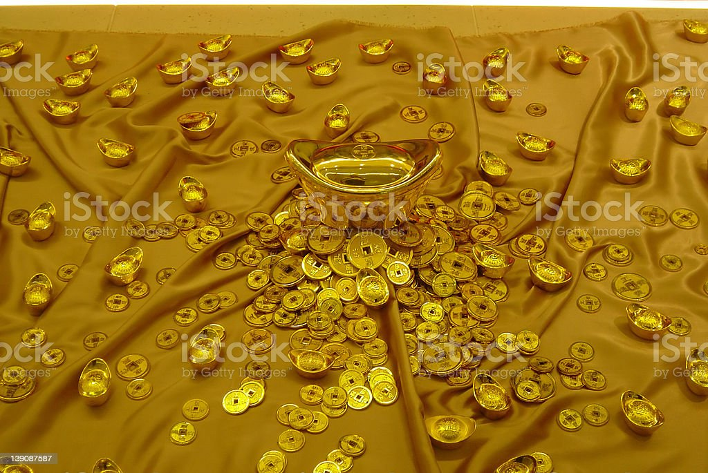 Chinese ingots and Gold coins royalty-free stock photo