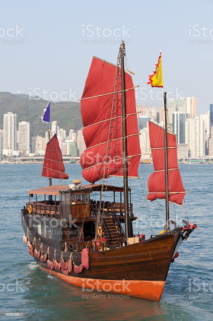 Chinese junk sailing across Hong Kong harbour stock photo