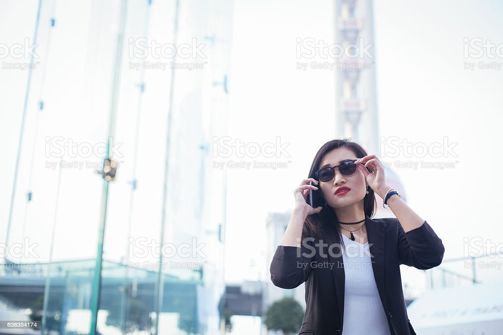 Chinese lady talks on cell stock photo
