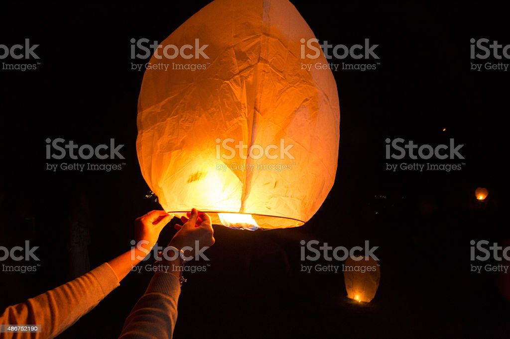 Chinese lantern being released stock photo