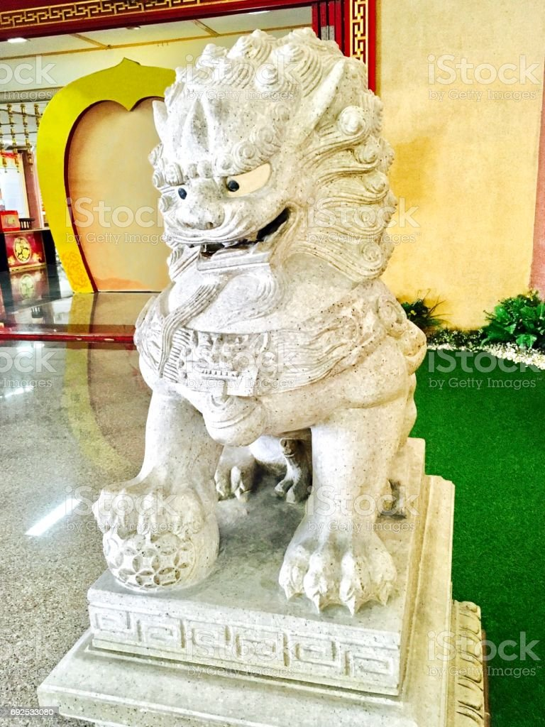 Chinese Lion Statue in Front of The Shrine stock photo