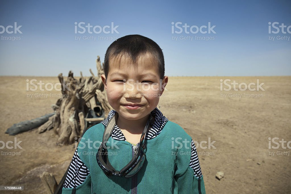 Chinese little boy standing before the wells stock photo