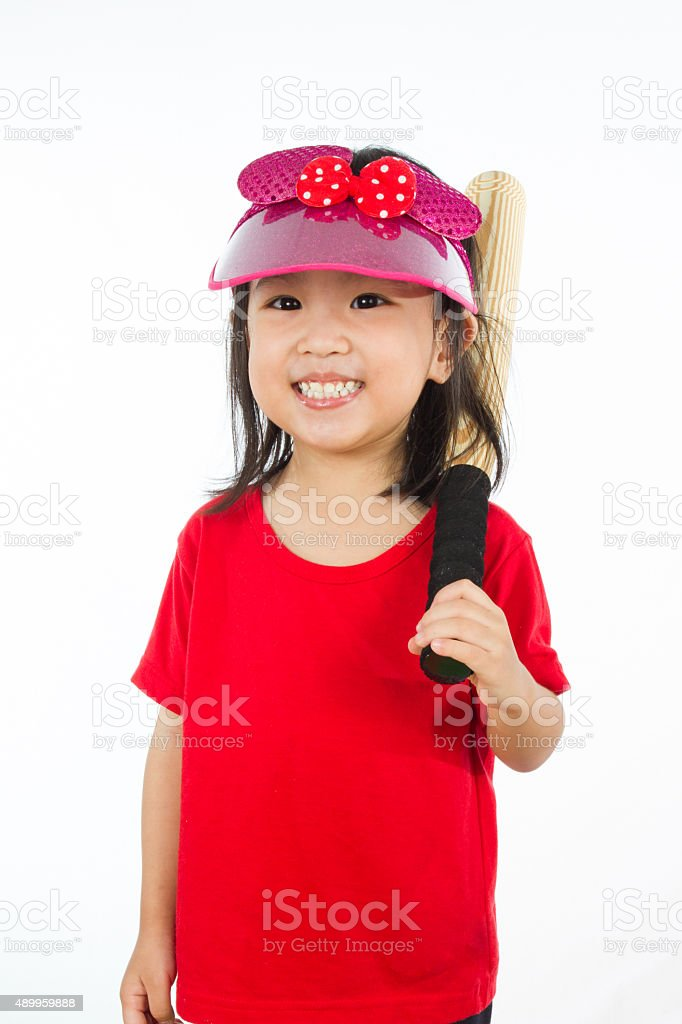 Chinese little girl holding baseball bat stock photo