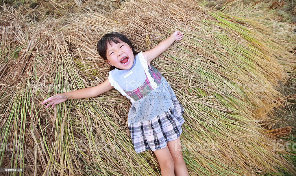 Chinese little girl on the straw stock photo