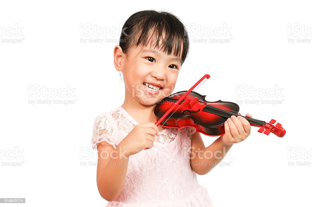 Chinese Little Girl Playing Violin stock photo