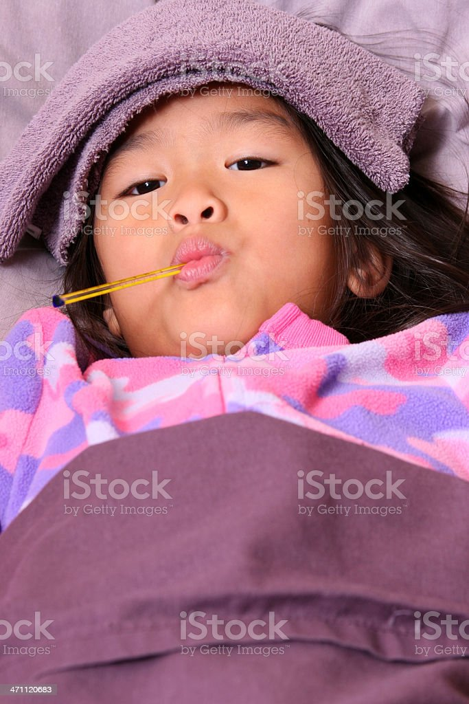 Chinese little girl with thermometer in mouth royalty-free stock photo