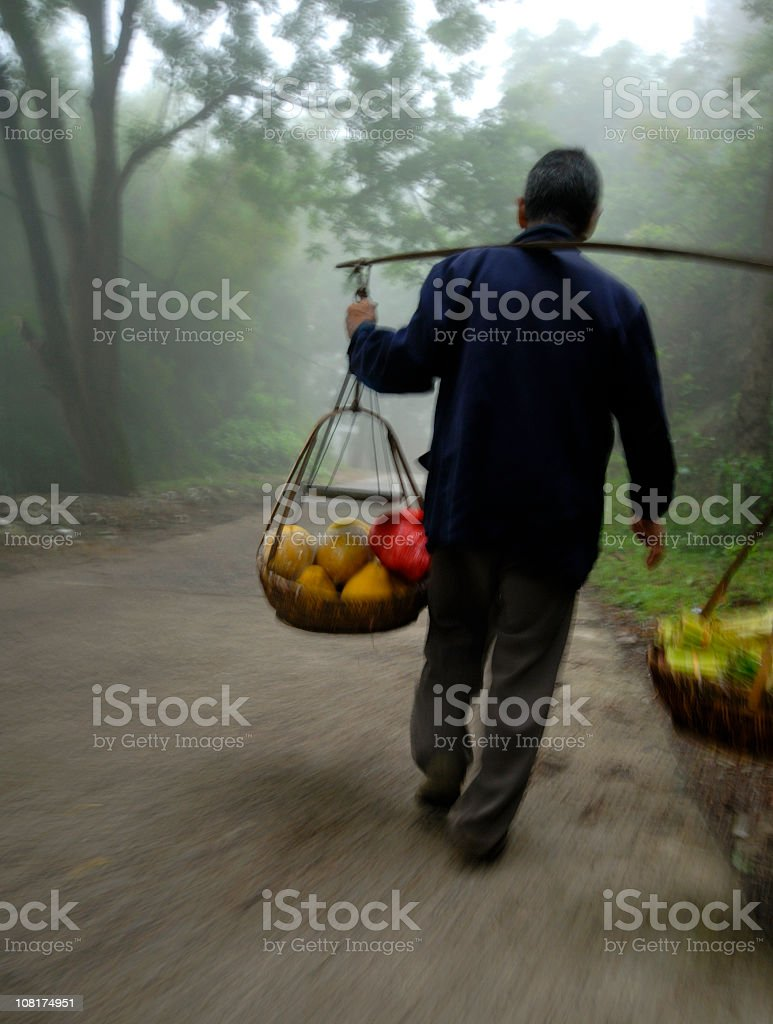 Chinese Man Carry Fruit royalty-free stock photo