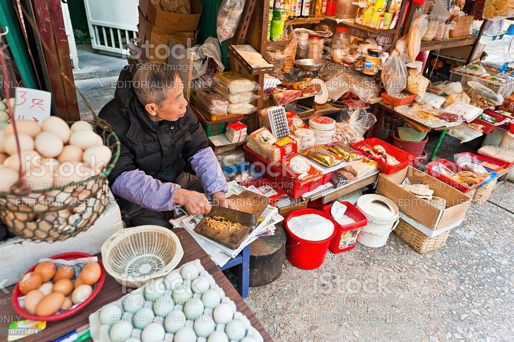 Chinese man chopping food street market stall Hong Kong China royalty-free stock photo