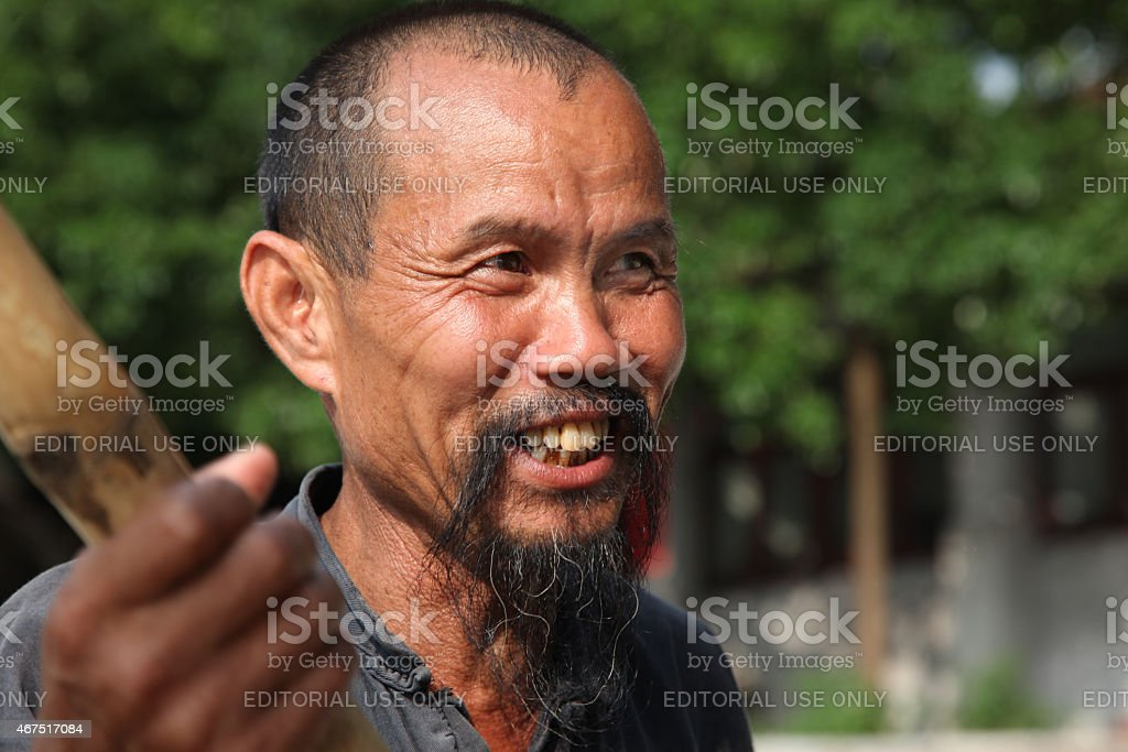 Chinese man in old hat Guangxi region stock photo