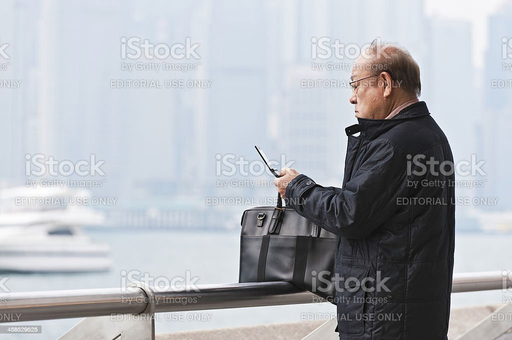 Chinese man using cell phone royalty-free stock photo