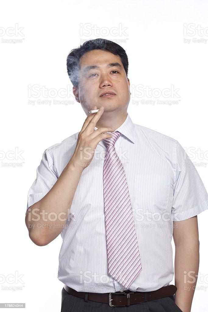 Chinese men smoke royalty-free stock photo