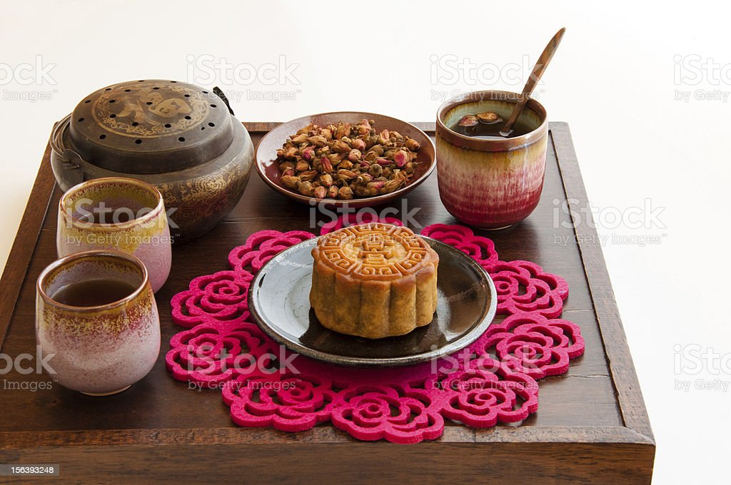 Chinese Moon Cake with rose tea. royalty-free stock photo