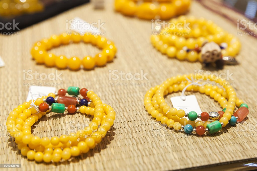 Chinese necklace made of yellow round stones stock photo