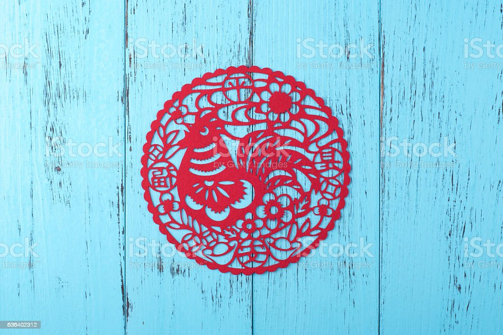 Chinese New Year decoration: chicken silhouette cut on weathered stock photo