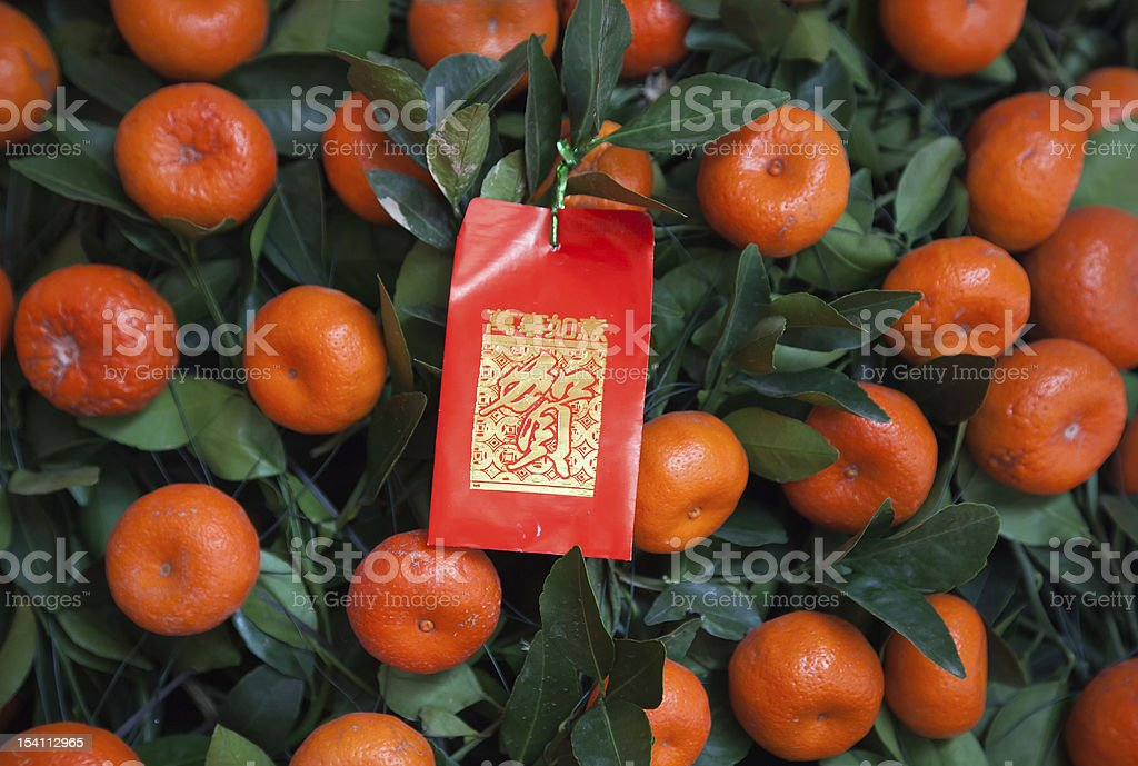 Chinese New Year Decoration - Red Packet on tangerines tree royalty-free stock photo