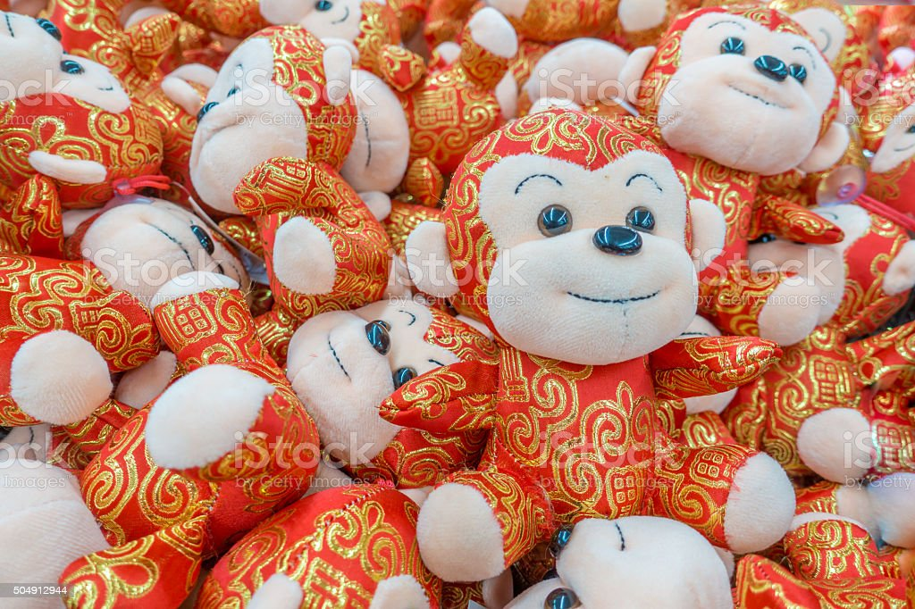 Chinese new year monkeys in gold and red stock photo