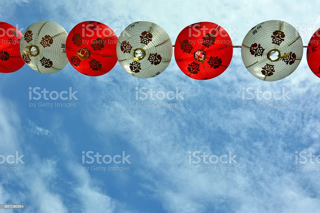 Chinese New year red lanterns against a blue sky stock photo