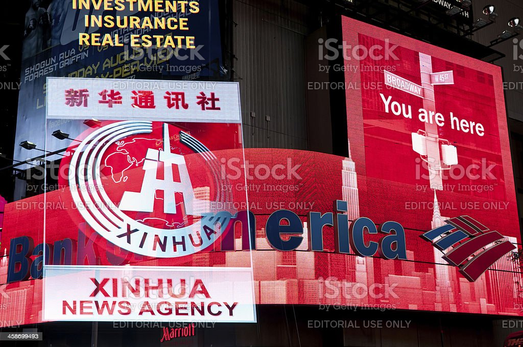 Chinese News agency Xinhua on Times Square royalty-free stock photo
