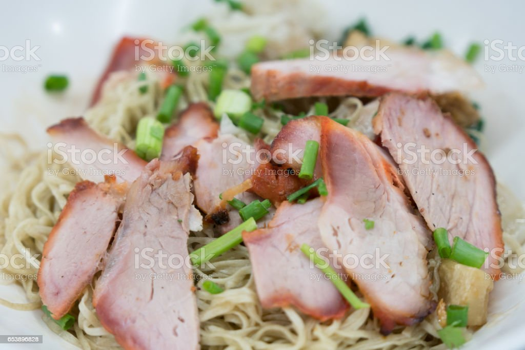 chinese noodle with red roast pork stock photo