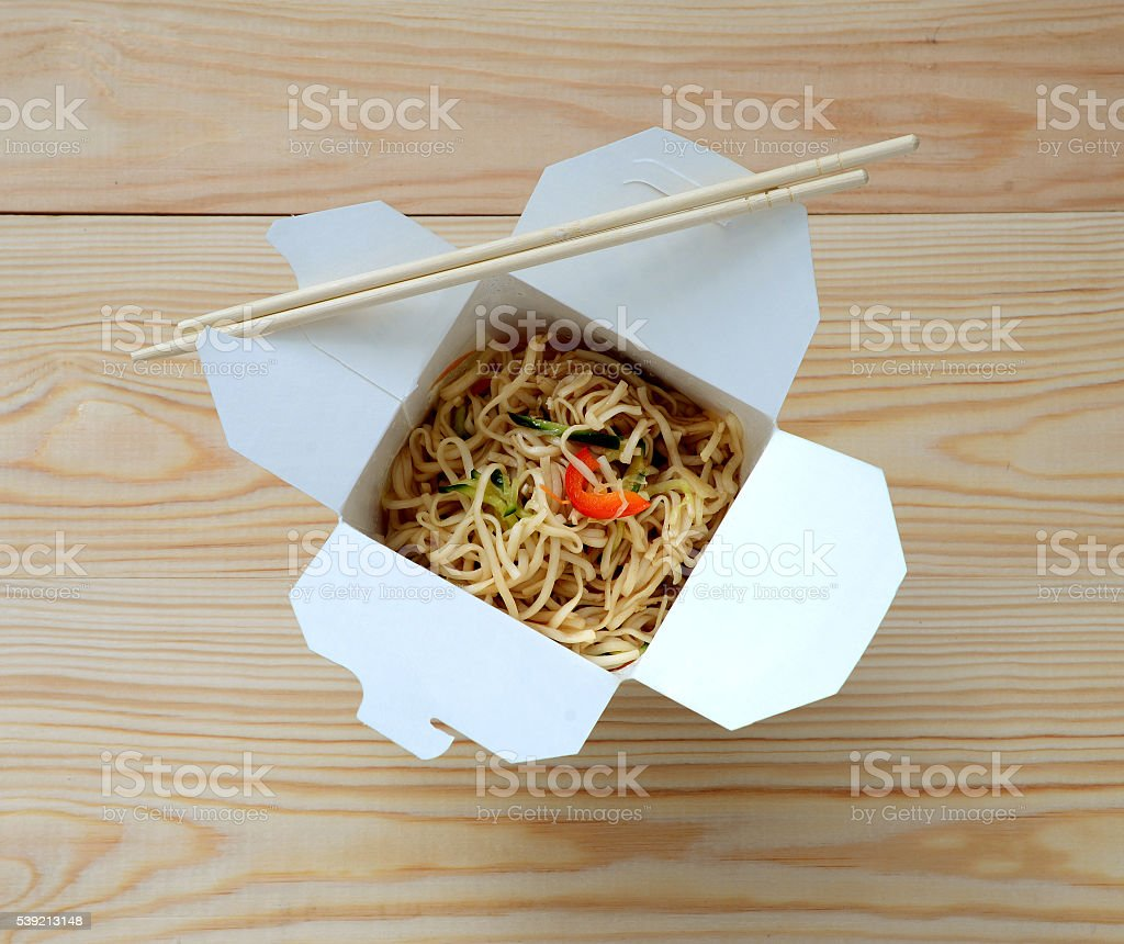 Chinese noodles in takeaway box. stock photo