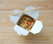 Chinese noodles in takeaway box.