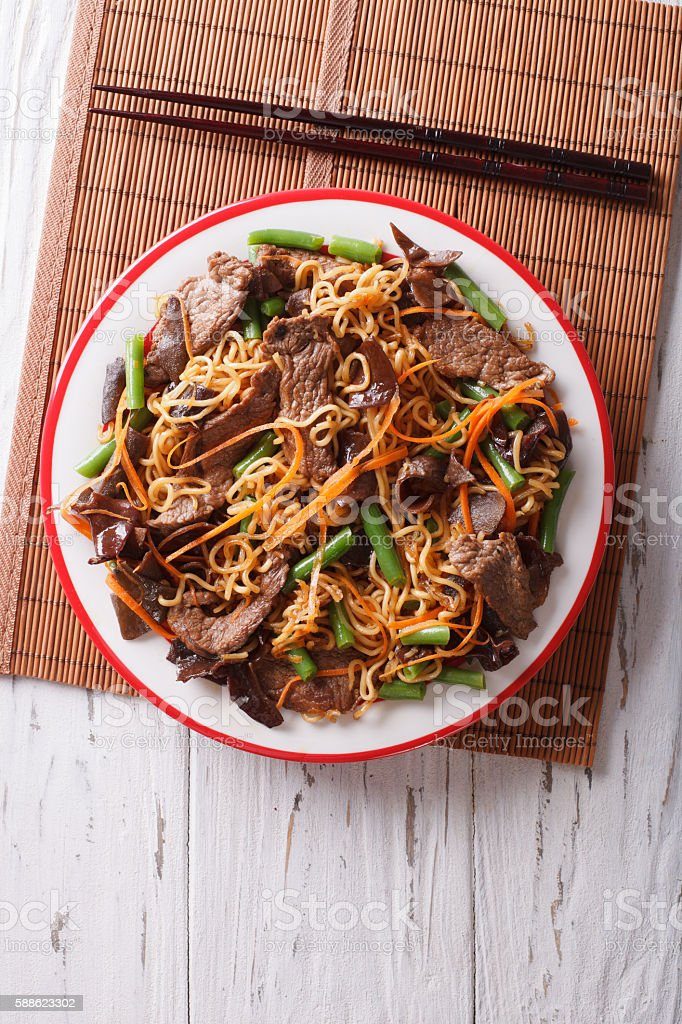 Chinese noodles with beef, muer and vegetables. vertical top view stock photo