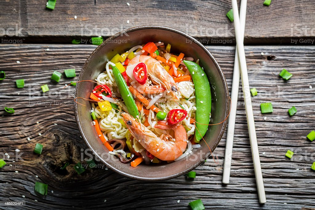 Chinese noodles with vegetables and prawns stock photo