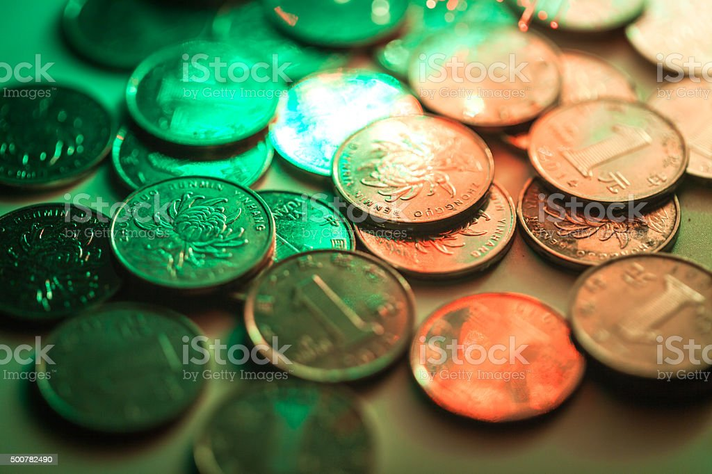 chinese one yuan coin stacked on the table stock photo
