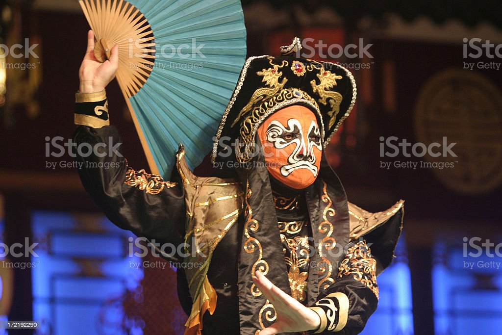 A Chinese opera actor performing with a mask on stock photo