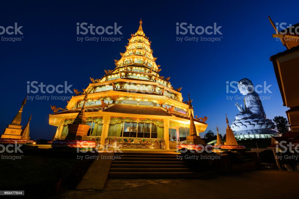 Chinese pagoda and Guan Yin statue with twilight sky in Wat Huay pla kang stock photo