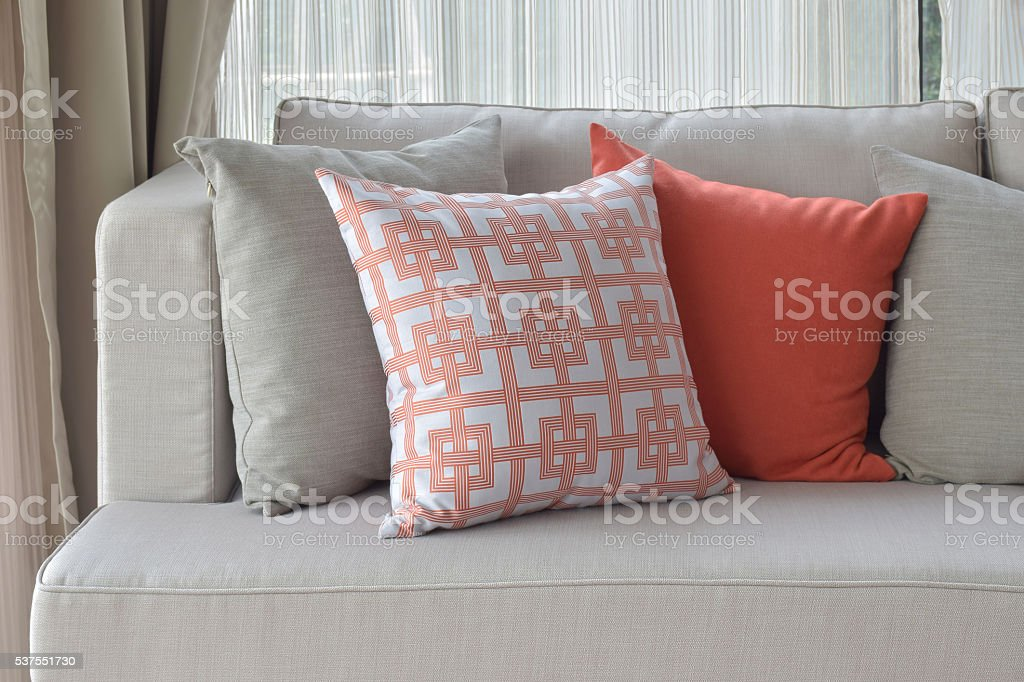 Chinese pattern pillow setting on light gray comfy sofa stock photo