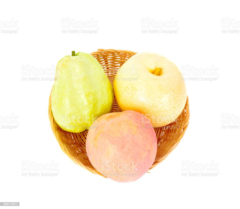 chinese pear, peach, guava fruit in the basket stock photo