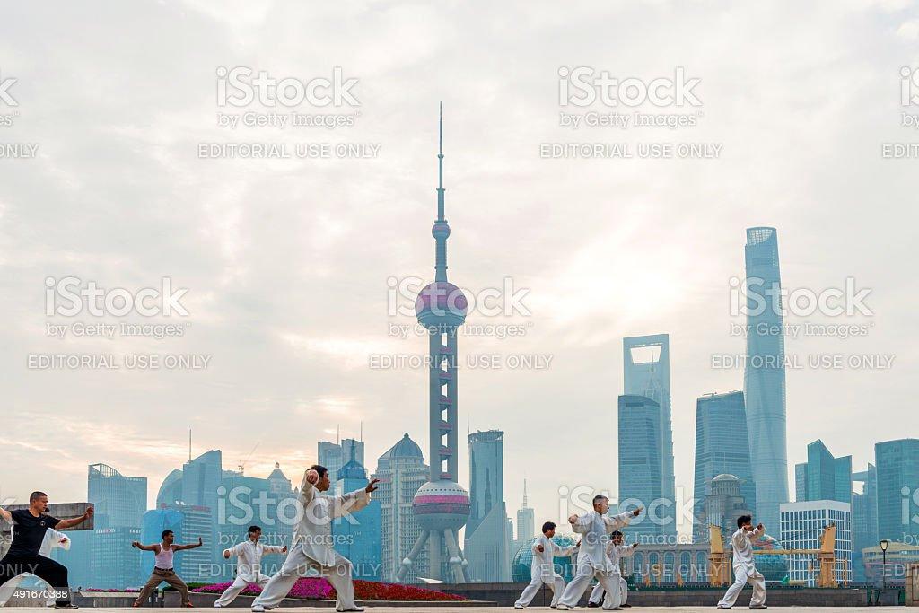 Chinese people in Shanghai Bund to play tai chi stock photo