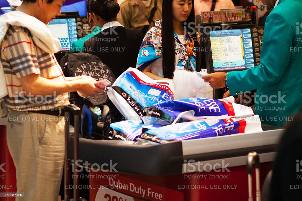 Chinese people paying duty free shopping in airport Dubai stock photo