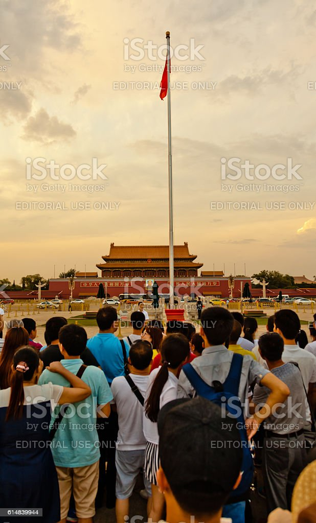 Chinese people waiting to watch the flag-lowering ceremony stock photo