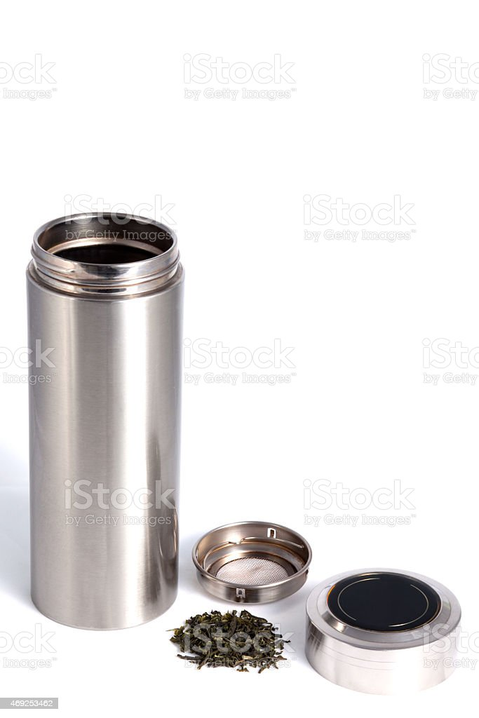 Chinese personal thermos with green tea leafs isolated on white stock photo