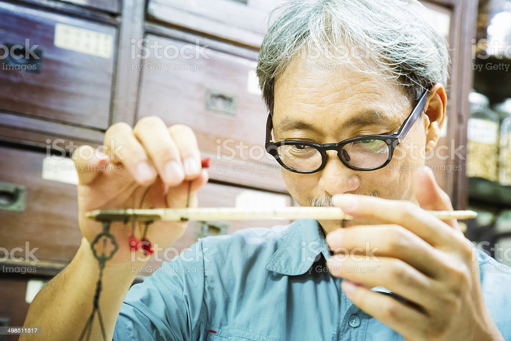 Chinese pharmacist using traditional scale stock photo