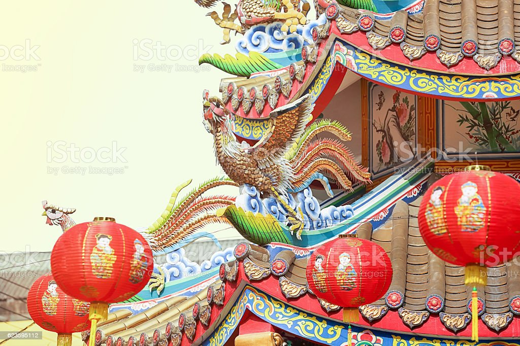 Chinese phoenix on temple roof stock photo