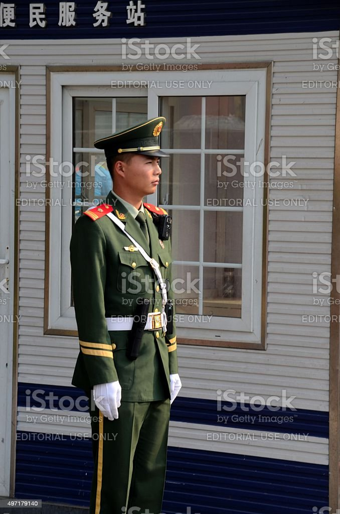 Chinese policeman smartly stands guard in Beijing China stock photo