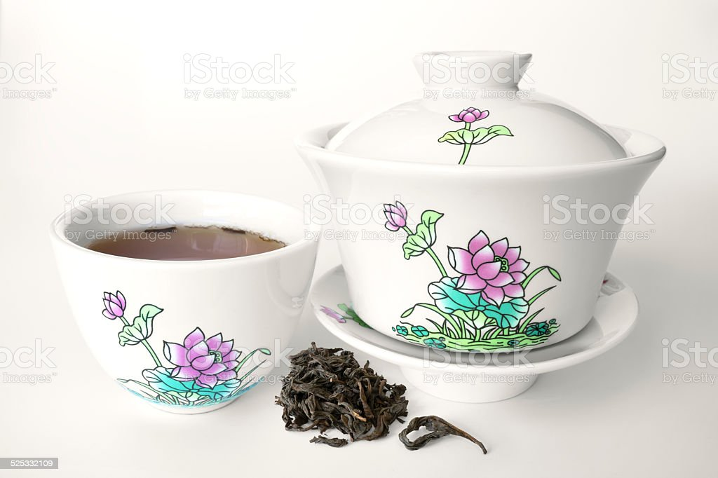 Chinese porcelain tea set with lotus drawing on white background stock photo