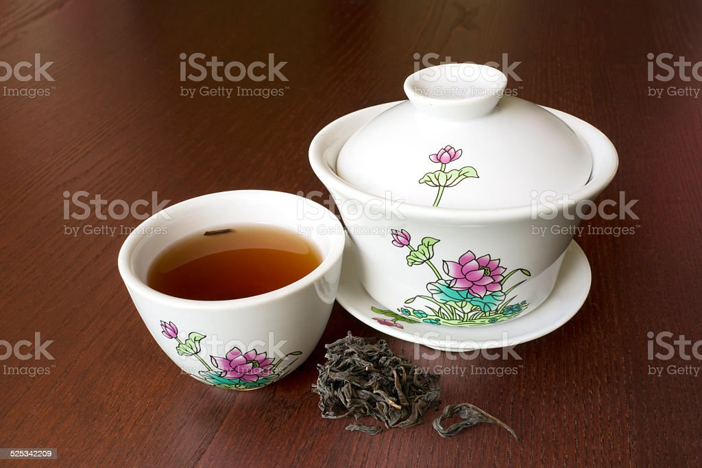 Chinese porcelain tea set with lotus drawing on wood table vector art illustration