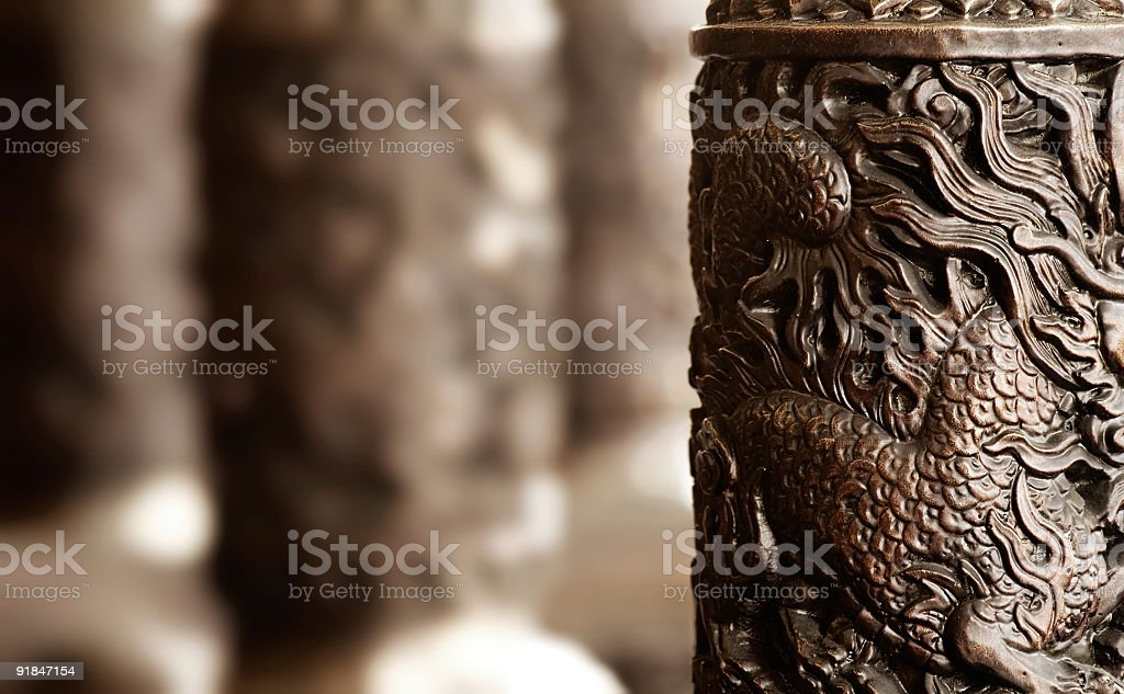 Chinese religious carving pillar decoration in golden royalty-free stock photo