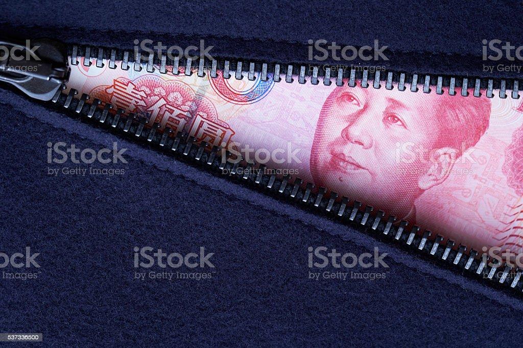 Chinese RMB bill and zipper stock photo