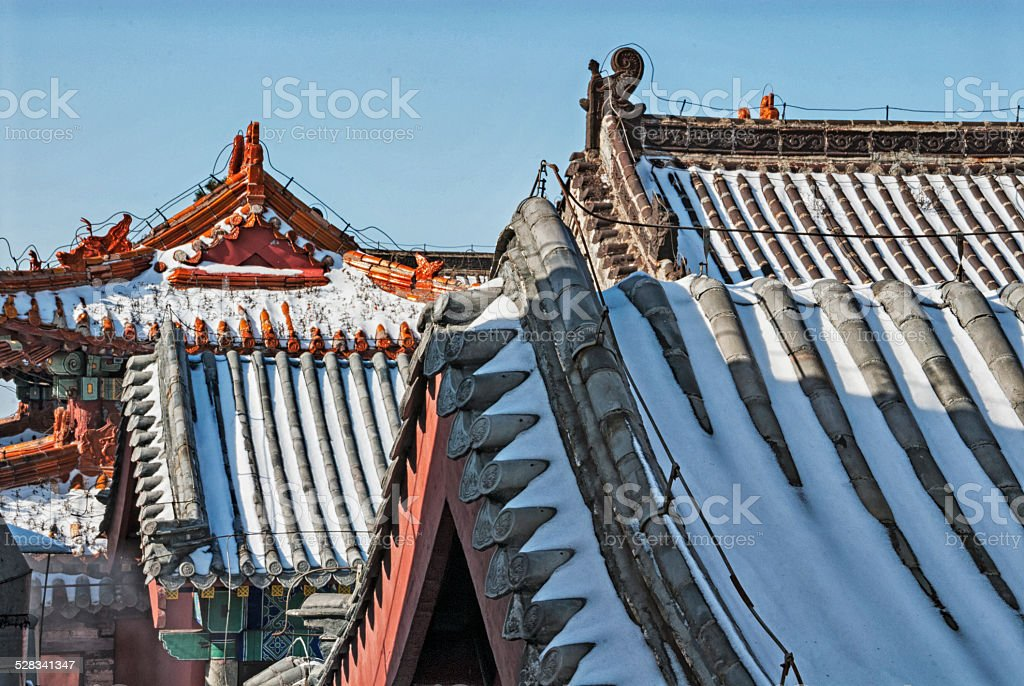 Chinese rooftops with snow stock photo