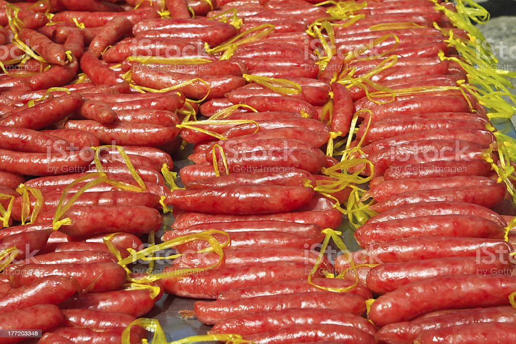 Chinese sausage are drying in greenhouse royalty-free stock photo