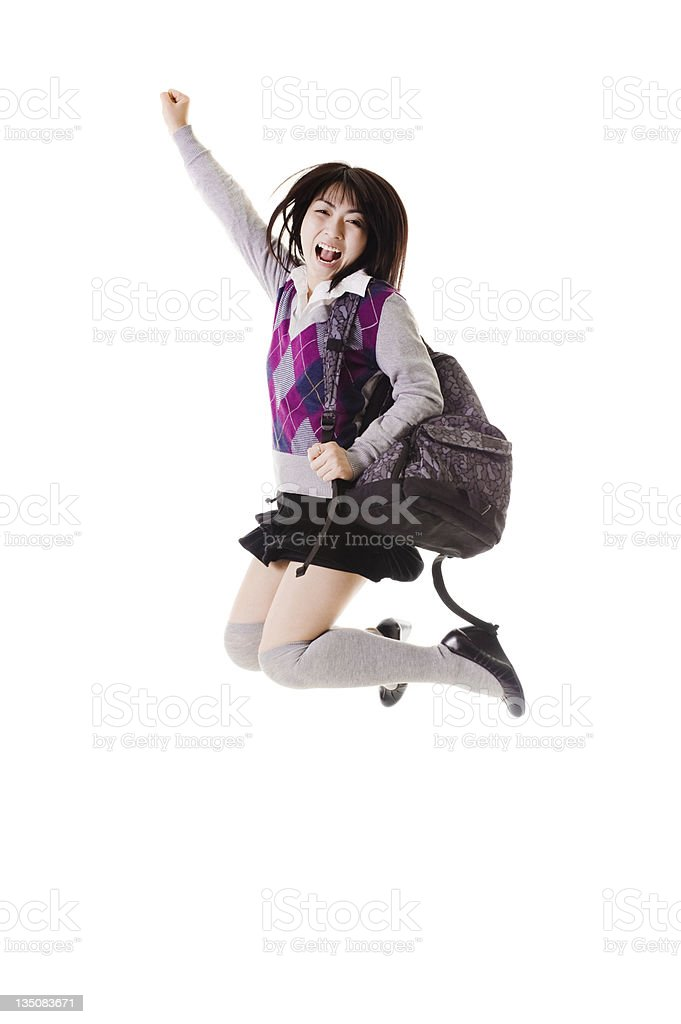 Chinese school girl jumping into air royalty-free stock photo