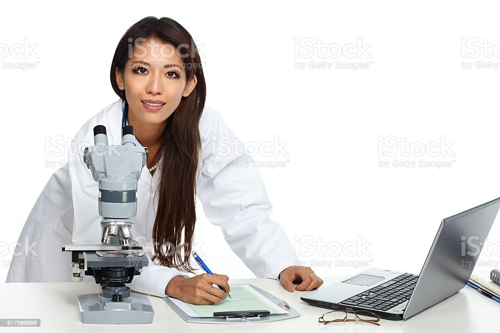 Chinese scientist woman with microscope. stock photo