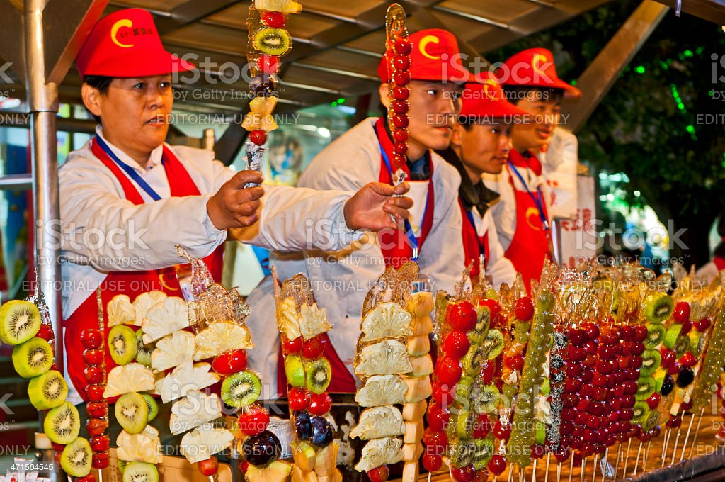 Chinese Selling Candy Fruit at Donghuamen Night Market Beijing royalty-free stock photo