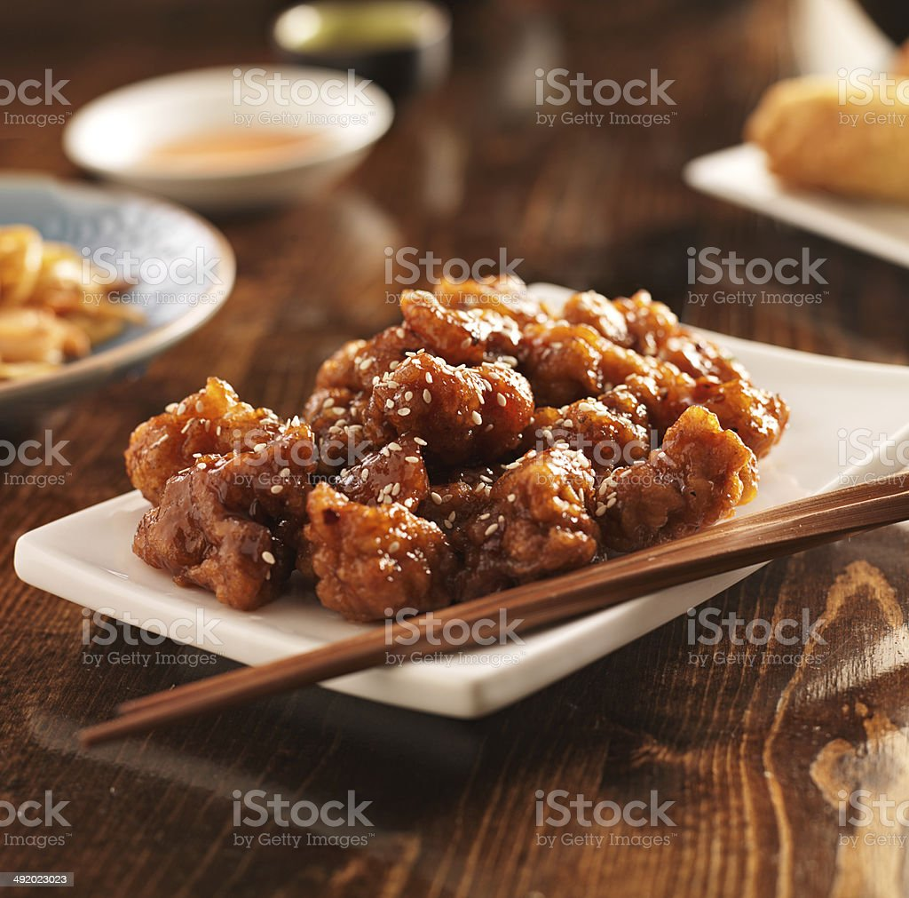 chinese sesame chicken with chopsticks stock photo